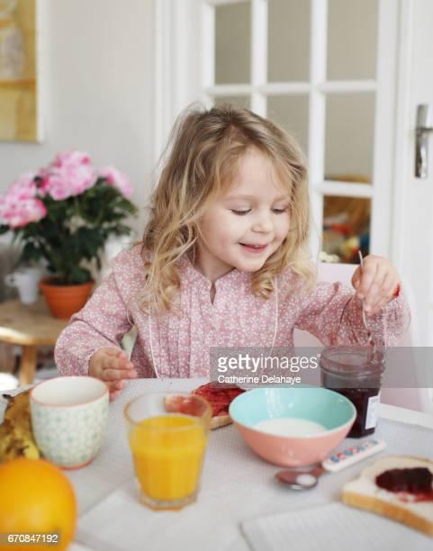 A girl having her breakfast