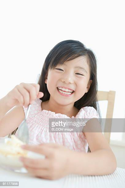 Girl having ice cream, smiling