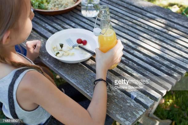 Girl having lunch in garden