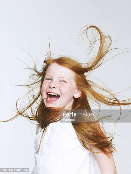 Girl (8-9) head banging, mouth open