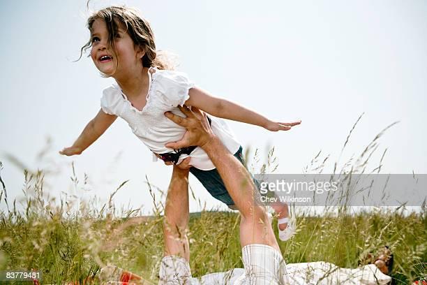 Girl held aloft flying