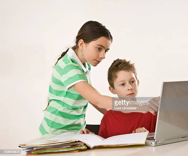 Girl helping a boy with his homework