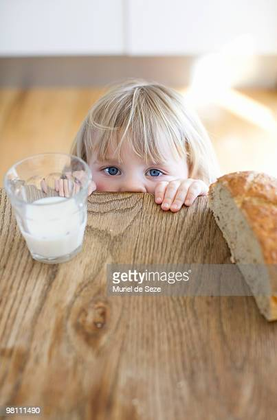 Girl hidding behind wooden table