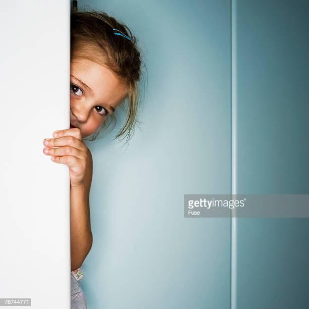 Girl Hiding Behind Door