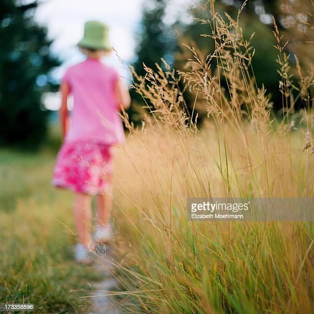 Girl hiking away on Trail