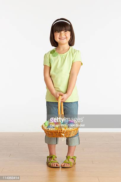 A Girl Holding A Basket Of Easter Eggs