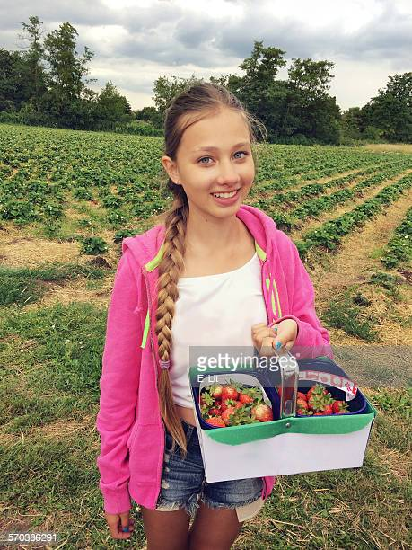 Girl Holding a Basket with Fresh Strawberries