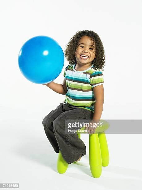 Girl holding a beach ball