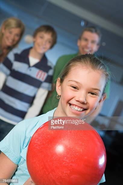 A girl holding a bowling ball Sweden.
