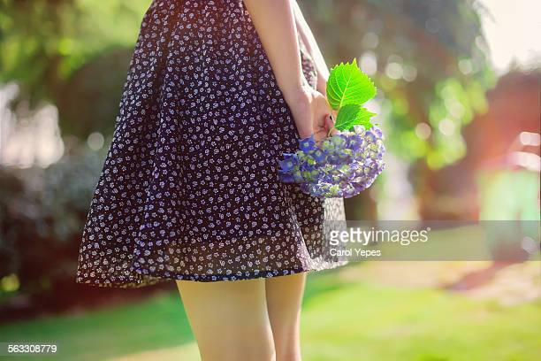 girl holding a bunch of purple hydrangeas