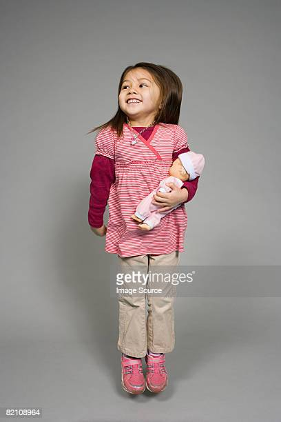 A girl holding a doll