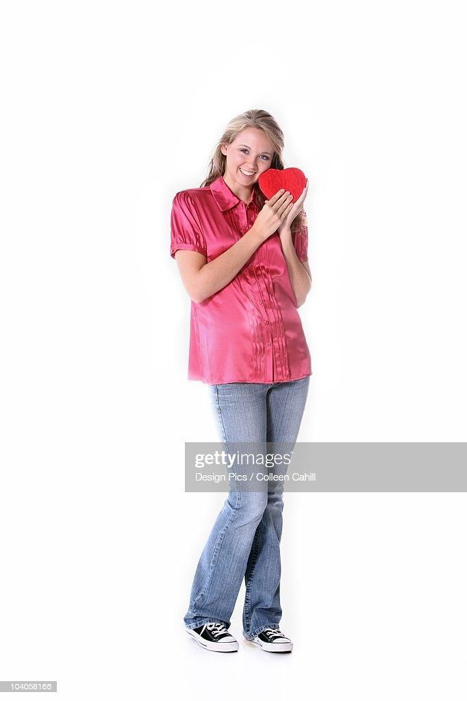 A Girl Holding A Heart : Stock Photo