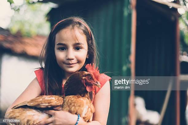 Girl holding a hen