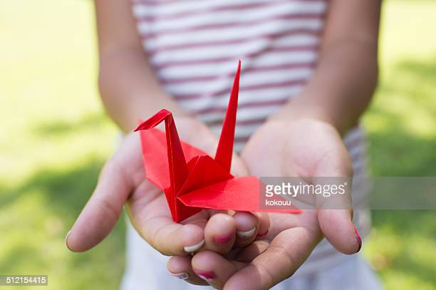Girl holding a paper crane