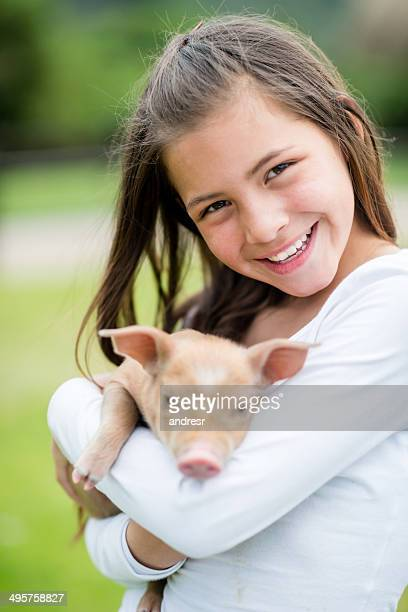 Girl holding a pig