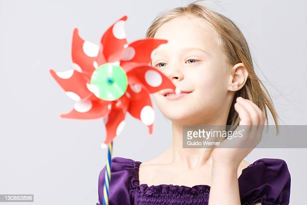 Girl holding a pinwheel or windmill
