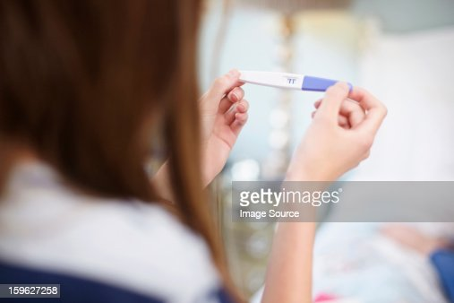 Girl holding a pregnancy test