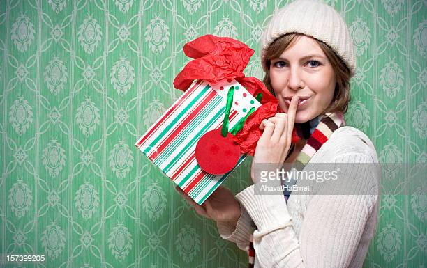 Girl holding a present for the holidays