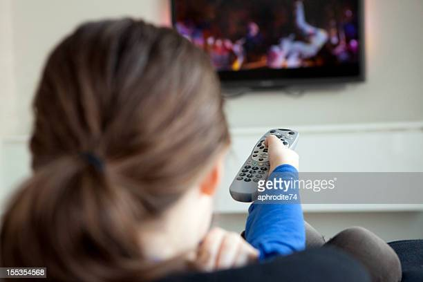 girl holding a remote control