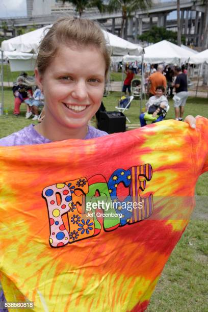 A girl holding a retro tshirt at Miami River day
