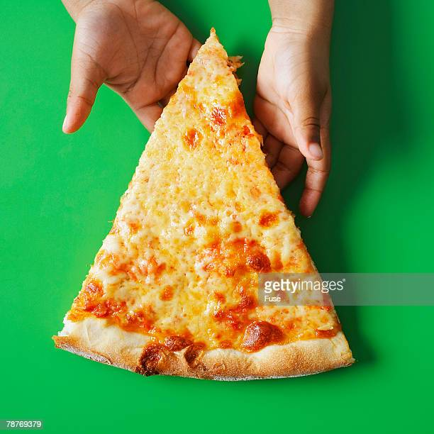 Girl Holding a Slice of Pizza