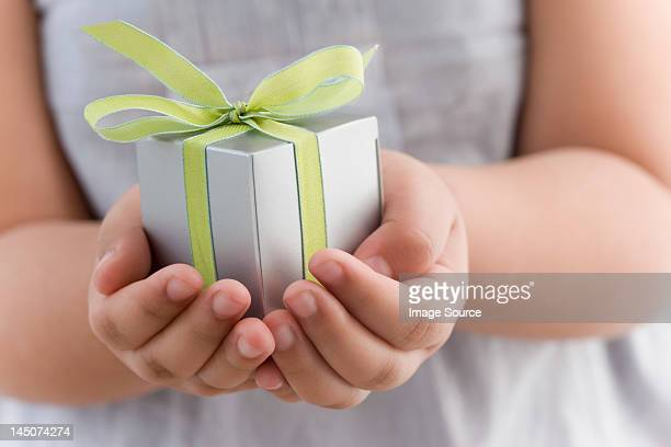 Girl holding a small gift