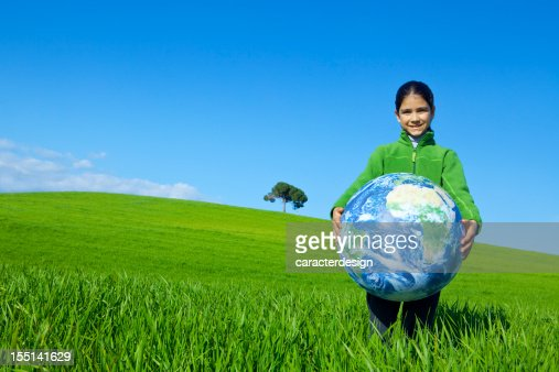 Girl holding a world globe