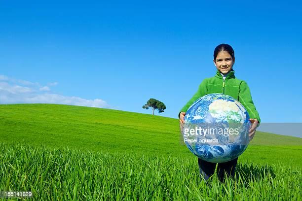 Girl holding a world globe