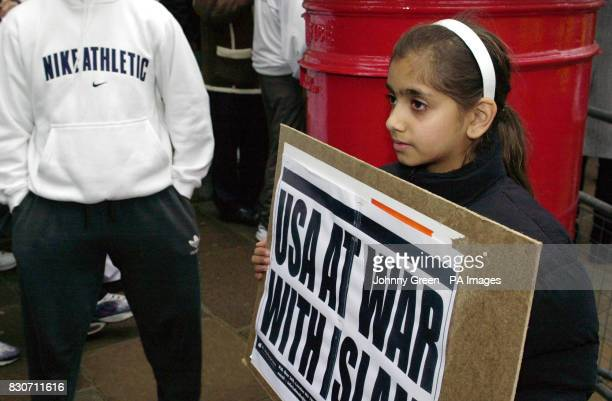 A girl holding an alMuhajiroun placard joins protestors outside the Pakistan High Commission offices in central London demonstrating against...
