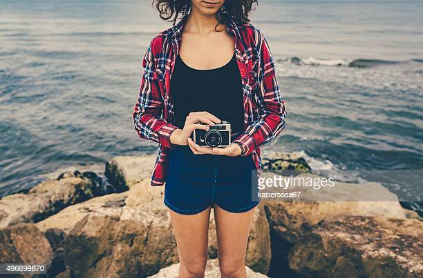 Girl holding an analog film camera