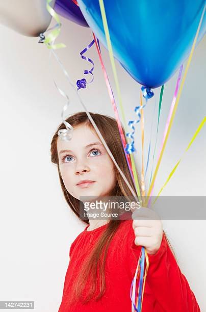 Mädchen holding Ballons