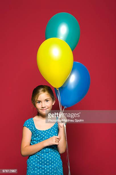 Girl holding balloons, portrait