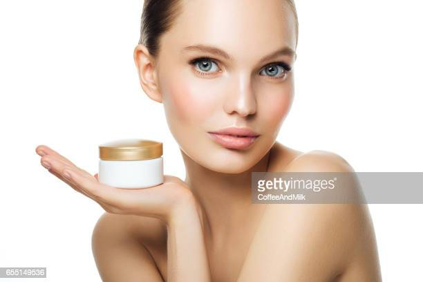 Girl holding bank of cream