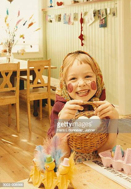 Girl Holding Basket of Eggs