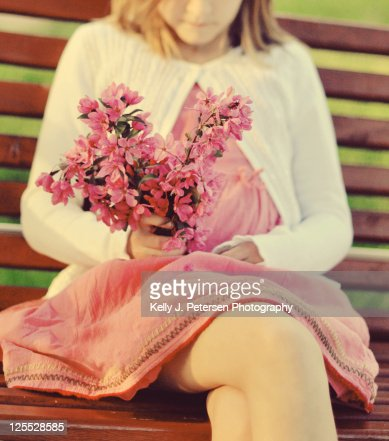 Girl holding bunch of pink flower
