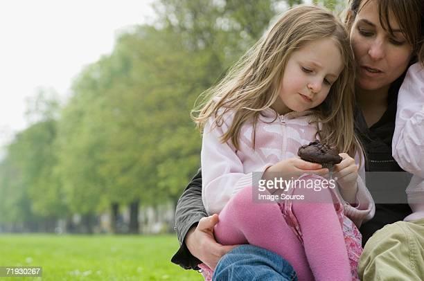 Girl holding chocolate cake