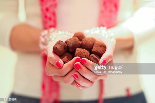 Girl Holding Chocolate Truffles