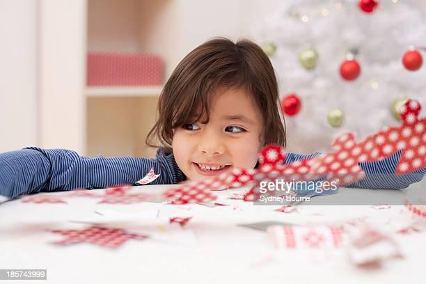 Girl holding Christmas decoration,  smiling