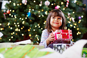 Girl Holding Christmas Gift