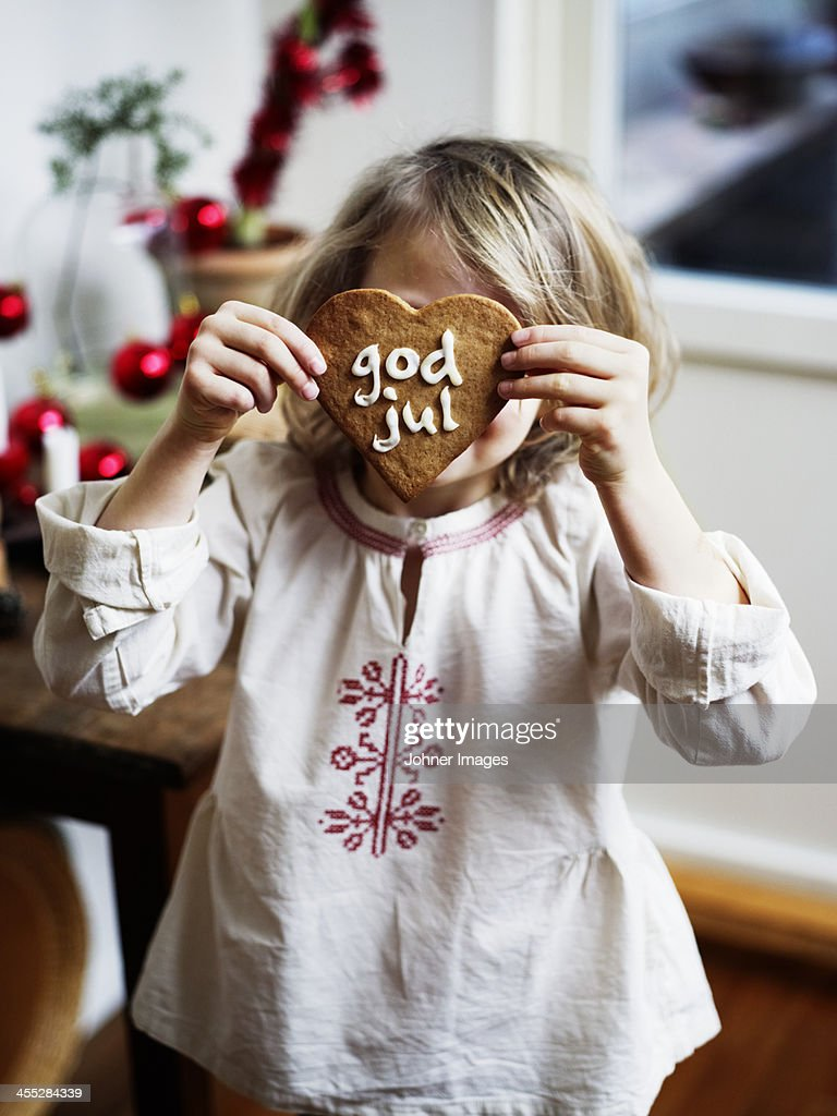 Girl holding Christmas gingerbread