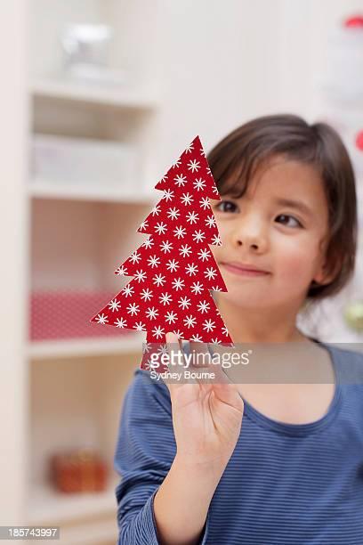Girl holding Christmas tree decoration