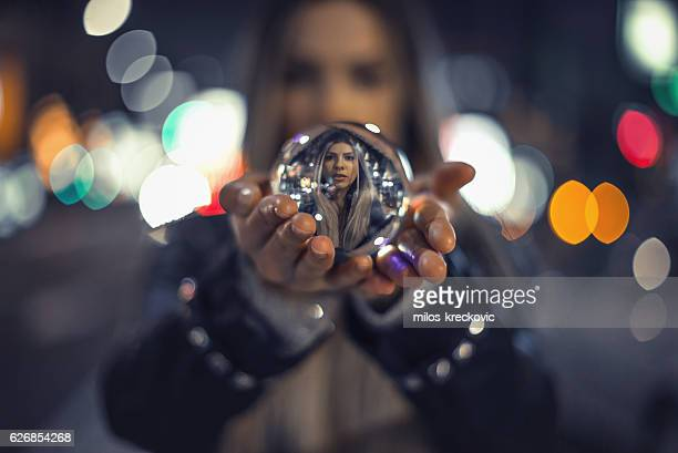 Girl holding crystal ball