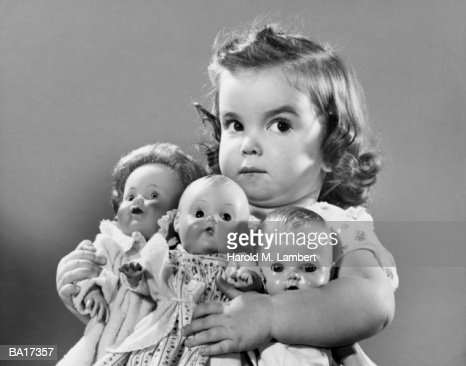 Girl (2-4) holding dollies, portrait (B&W) : Stock Photo