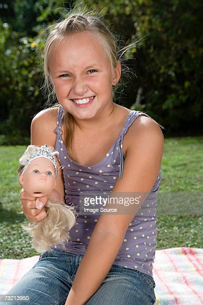 Girl holding dolls head