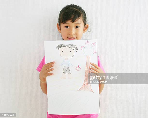 Girl Holding Drawing Paper