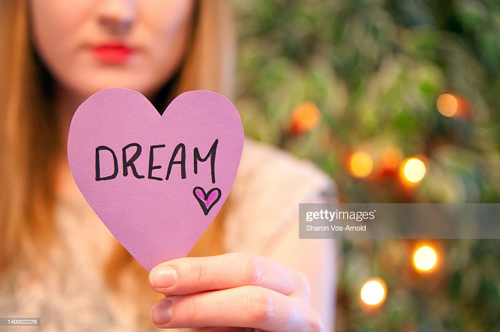 Girl holding dream/heart note in her hand