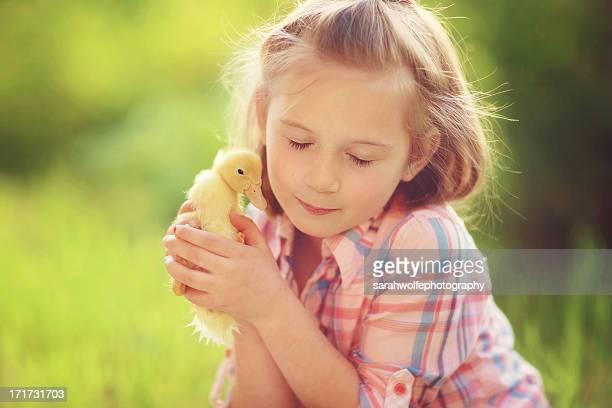 girl holding duckling