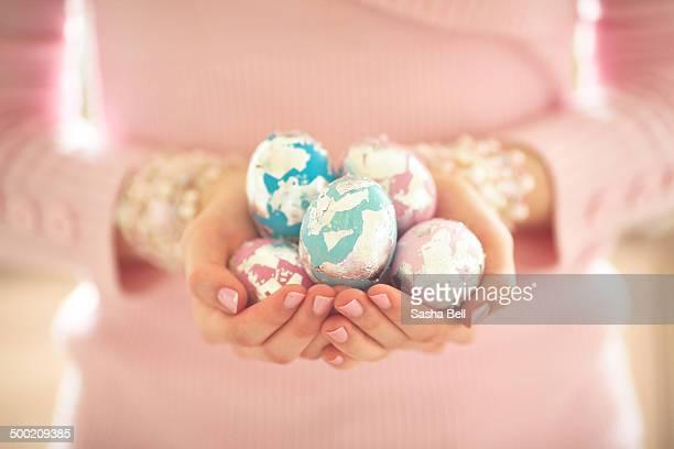Girl Holding Easter Eggs In Her Hands