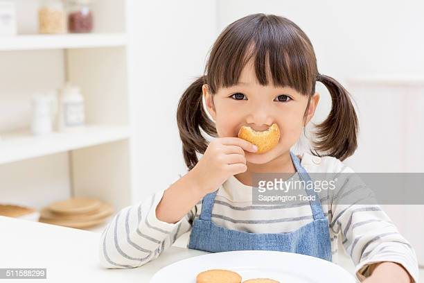 Girl Holding Eaten Biscuits