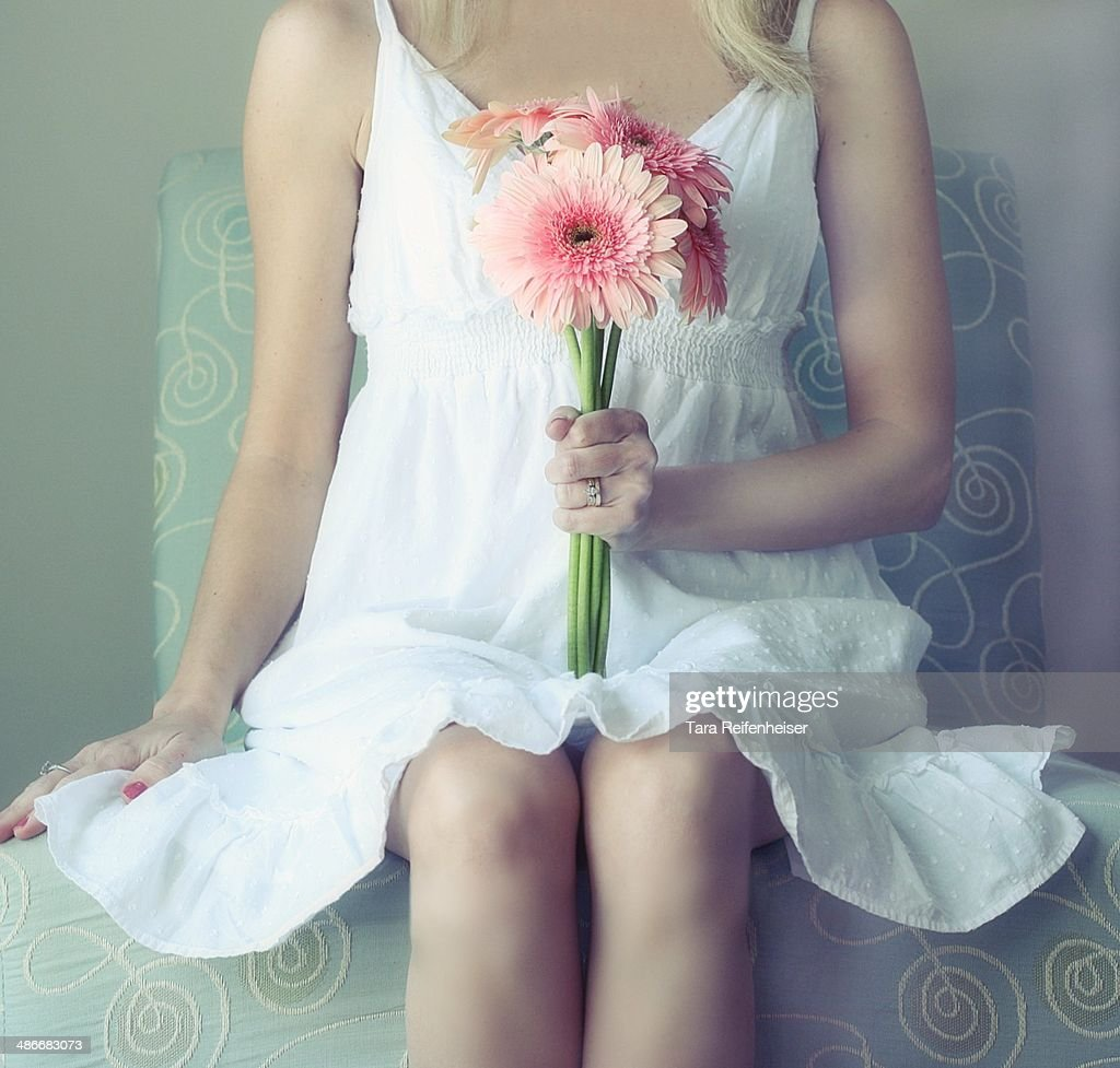 Girl holding flowers- Gerbia Daisies